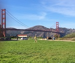 Chris Pymm Playing Frisbee at the Golden Gate Bridge